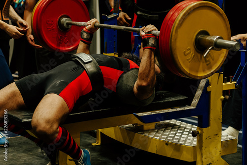 bench press indian athlete attempt with heavy barbell Canvas Print