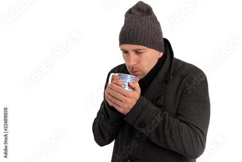 Fotografie, Obraz  Mann im Winter mit Mütze und Tasse