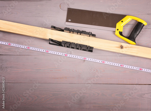 Fotografie, Obraz  tools for sawing wooden bars on the workbench