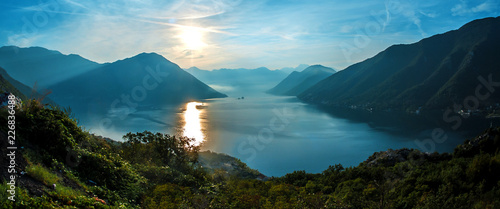 Panorama of Mediterranean Sea surrounded by mountains at colorful sunset