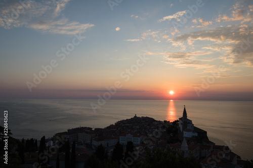 beautiful village of Piran on adriatic sea coastline in sunset silhouette, Slovenia