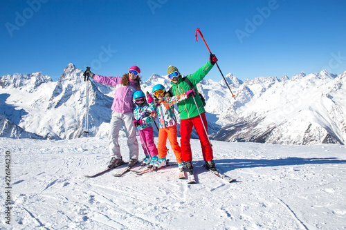 Wall Murals Winter sports family in alpin ski resort
