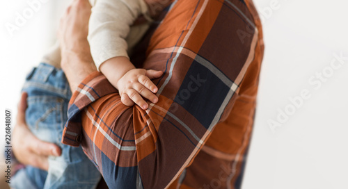 Obraz family, fatherhood and people concept - close up of father holding little baby - fototapety do salonu