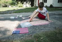 Boy Drawing American Flag On A...