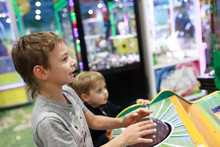 Brothers Playing Arcade Game