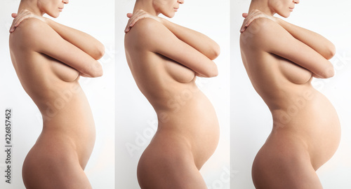 Nude anonymous pregnant woman profile on white background Wallpaper Mural