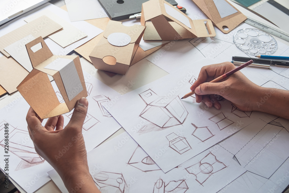 Fototapety, obrazy: Designer sketching drawing design Brown craft cardboard paper product eco packaging mockup box development template package branding Label . designer studio concept .