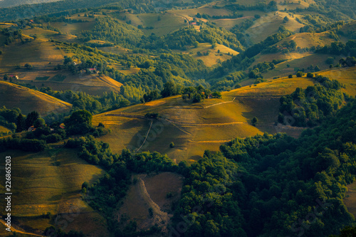 Houses from a village placed on top of the hills seen from above in a beautiful scenic landscape