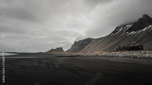 Stokksnes cape and Vestrahorn Mountain. Landscape with popular tourist attraction in Iceland. Exciting excursion to the sightseeing in autumn mood