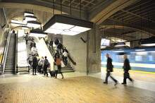 Commuters Exiting A Metro Rail Station