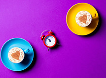 Blue And Yellow Cups And Clock...