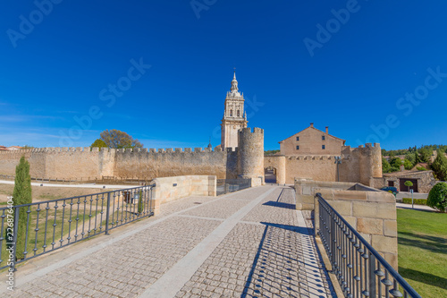 bridge towards access to Burgo de Osma medieval town, exterior wall and tower of cathedral, landmark and monument from thirteenth century, in Soria, Spain, Europe
