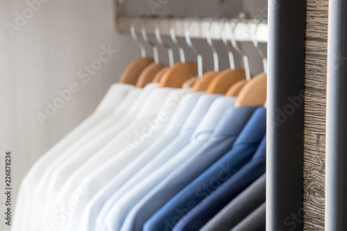 Office Business shirts hanging in a closet ordered by colour Canvas-taulu