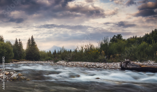 Foto auf Gartenposter Fluss Bela River with Krivan Peak in Background at Sunset in Slovakia