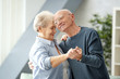 canvas print picture - Cute elderly couple dancing at home