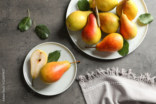 Flat lay composition with ripe pears on grey background
