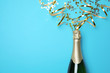 canvas print picture - Creative flat lay composition with bottle of champagne and space for text on color background