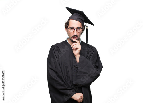 Photo graduate bearded man with a goofy, dumb, silly look, feeling shocked and confused at a recent realization, not really understanding an idea