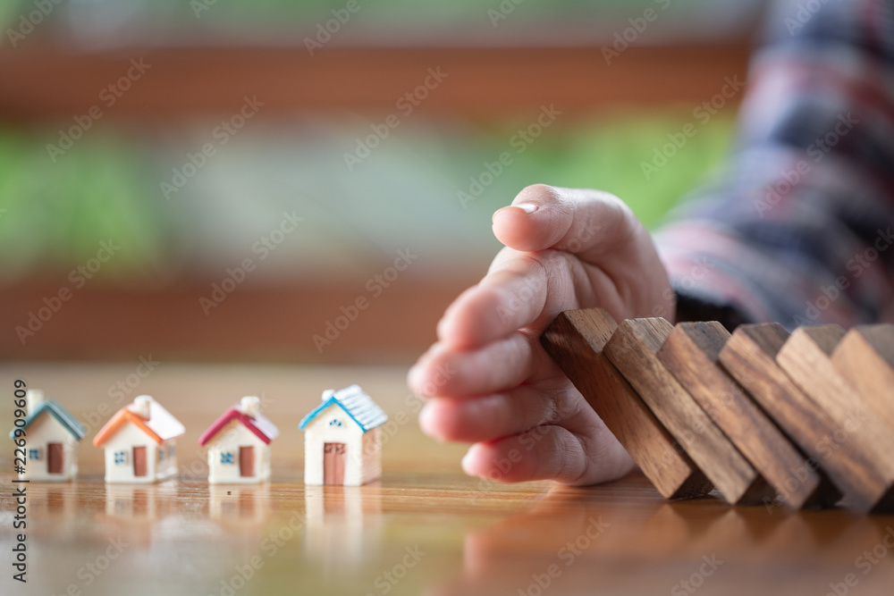 Fototapeta Business woman covering home with hands, insurance concept