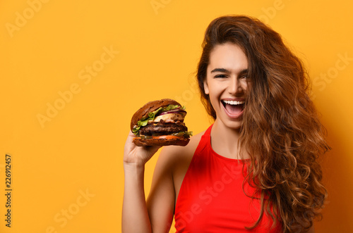 Woman hold big barbecue burger sandwich with hungry mouth happy screaming laughi Fototapeta