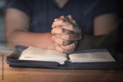 Woman praying on holy bible in the morning  Teenager woman