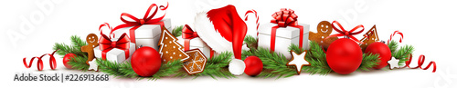 Fotomural Weihnachtsschmuck mit Geschenken, Lebkuchen, Nikolaus Mütze, Weihnachtskugeln un