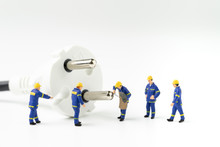 Sustainable Energy, Power Consumption Or Electricity Innovation Concept, Miniature People Worker, Technician Help Fixing Or Building Electricity Plug On White Background With Copy Space