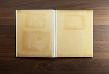 Blank Page Of An 1970s Photo Album, On A Dark Colored Wooden Table.