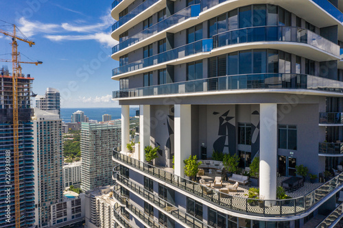 Aerial Miami Brickell highrise tower with recreational amenities area