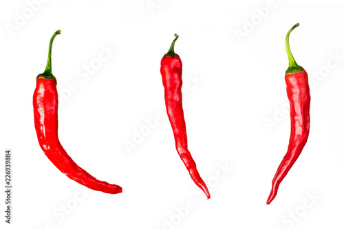 Staande foto Hot chili peppers three pieces of chili peppers