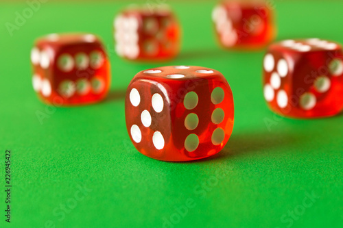Fotografija  Dice on a green background . Game concept. Games of chance