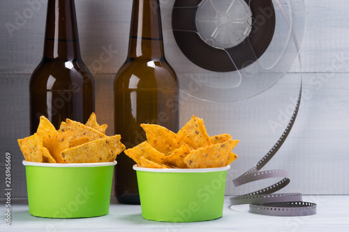 buckets of nachos with two bottles of beer, to view the old videotape