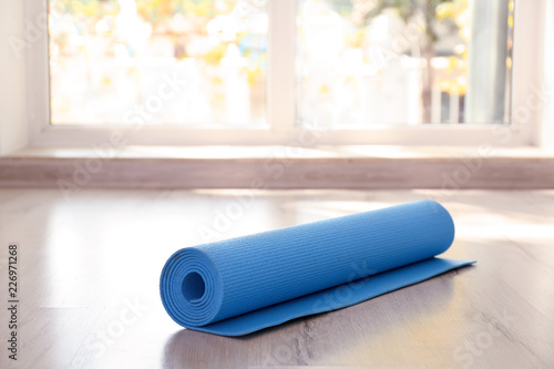 Obraz Yoga mat on floor indoors - fototapety do salonu