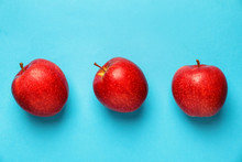 Ripe Red Apples On Color Background