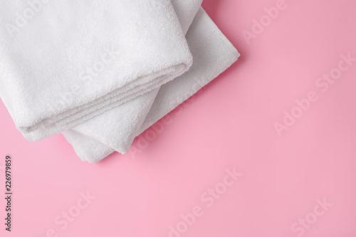 Fotografia  Clean soft towels on color background
