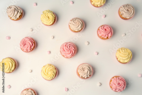 Delicious cupcakes on white background, flat lay Wallpaper Mural