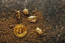 Bitcoin And Gold Nuggets On Grey Background