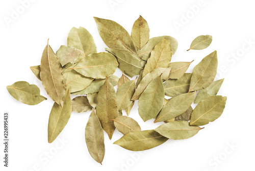 Dried bay leaves stack isolated on white.