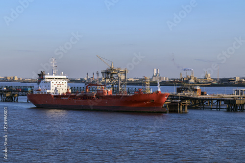 Ship moored near an oil refinery - Humber Estuary - England.
