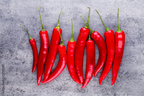 Staande foto Hot chili peppers Chili cayenne pepper on grey background.