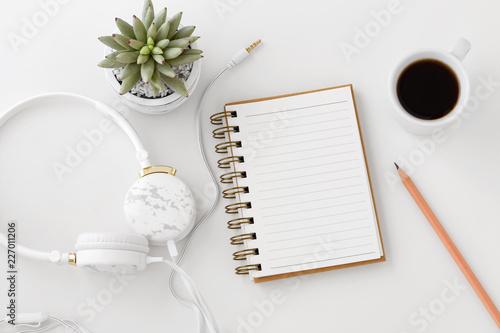Fototapeta  Headphones with notebook on white desk