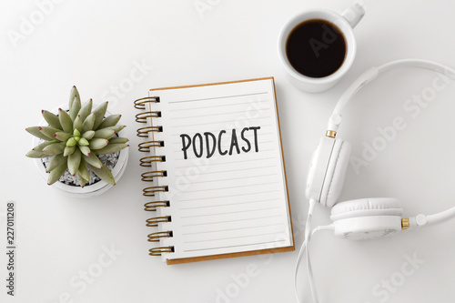 Fotografie, Obraz  Podcast word on notebook with headphones