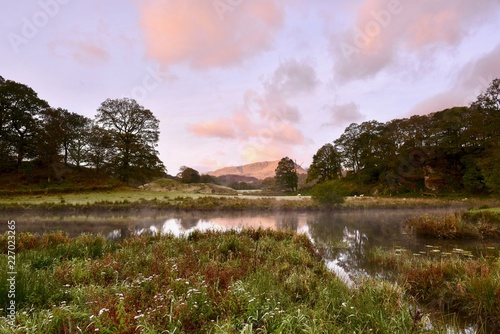 Foto op Plexiglas Purper Dawn over Elter Water
