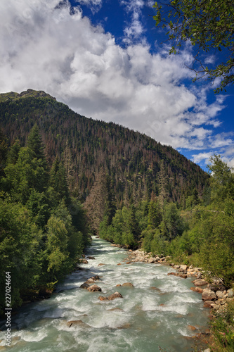 Mountain river with a rapid flow in the Caucasus Range ..