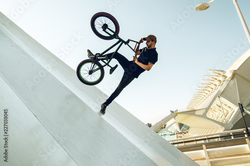 Young man doing street tricks with a bmx