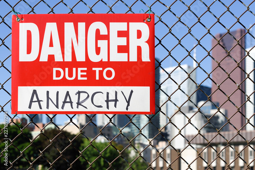 Sign danger due to anarchy hanging on the fence Canvas-taulu