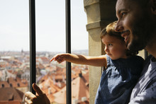 Czechia, Prague, Father And Little Daughter Looking Together At View From The Old Town Hall