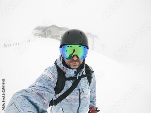 Italy, Modena, Cimone, portrait of man wearing ski goggles and helmet in haze
