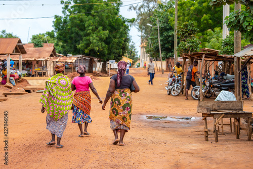 Togoville village in Togo  Women walking in African outfits