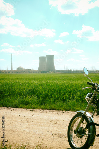 Deurstickers Fiets Green meadow nature germany Summer landscape silence background mystic nuclear power station